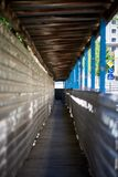 Temporary pedestrian tunnel in the construction area stock photography