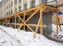 Temporary protected pavement near the reconstructed building. Murmansk, Russia - March 14, 2017: Temporary protected pavement near the reconstructed building Royalty Free Stock Photos