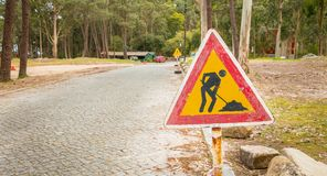 Temporary road sign indicating work on a small road in the fores royalty free stock images