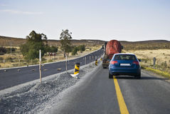 Temporary Road, Single Lane Traffic. Traffic is reduced to Single lane, stop/go controlled flow, during road construction operations Royalty Free Stock Photography