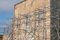 Scaffolding. Temporary scaffold for construction works Stock Images
