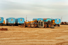 Temporary site office and machinery Royalty Free Stock Photos