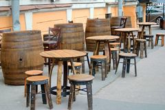Temporary street cafe with retro chairs and tables made of barrels. Saint Petersburg, Russia. royalty free stock image