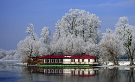 Temporary structure of white under the red roof near the river s Stock Photo
