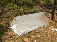 Temporary survival shelter. Made from large clear plastic bags, gaffer's tape, and a few sticks Royalty Free Stock Photography
