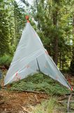 Temporary survival shelter. Made from large clear plastic bags, gaffer's tape, and a few sticks Stock Photography