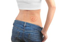 Temporary tattoo on back. Temporary tattoo on woman back stock images