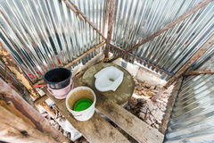 Temporary toilet at construction site. Inside of temporary toilet at construction site stock photography