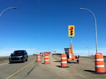 A temporary traffic light turned red at a construction site for bridge renovations. Edmonton, Alberta, Canada - April 7th, 2019: A temporary traffic light turned royalty free stock photo