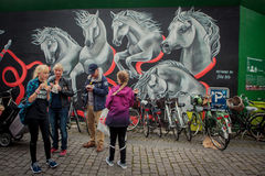Temporary wall with graffiti painting by Stine Hvid in the centre of Copenhagen royalty free stock photo