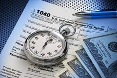 Temps de 1040 impôts Photos stock