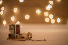 Temps de Noël avec le bokeh et le chariot Image stock