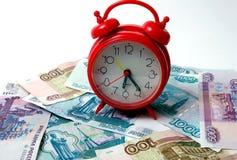 Temps - un argent. Images libres de droits
