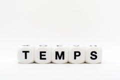 Temps, Würfelbuchstaben Stockfotografie