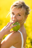 Temptation. Beautiful young girl with apples - like Eve from bible Royalty Free Stock Image