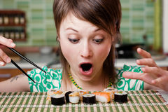 Temptation. An image of a woman looking at sushi Stock Image