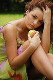Temptation 2. Young attractive red hair beauty with apple Royalty Free Stock Images