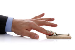 Temptation. Caught in a mousetrap concept for temptation, corporate crime or an accident Royalty Free Stock Images