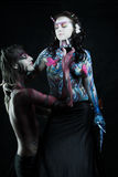 Temptation. A couple with paint on their bodies. Studio shot, isolted on black background Royalty Free Stock Image