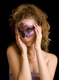 Temptation. Portrait of mysterious blond woman wearing purple stylish carnival mask; role play Stock Photography