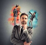 Temptation. Of a businessman with angel and devil royalty free stock images