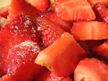 Temptation dessert II. Sliced strawberries with sugar stock images