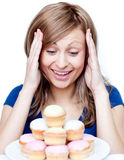 Tempted woman in front of cakes Royalty Free Stock Photography