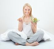 Tempted young woman making a food choice Royalty Free Stock Photos