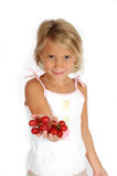 Tempting. Little girl holds out hand to tempt you to eat grapes. Little child hods out healthy food choice Royalty Free Stock Photos