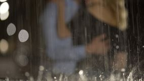 Tempting kiss of loving couple standing under the rain, romance, passion. Stock footage stock footage