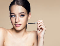Tempting young woman with lip brush Royalty Free Stock Image