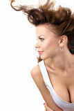 Temptress. Seductive girl with flying hair and decollete, isolated Stock Photography