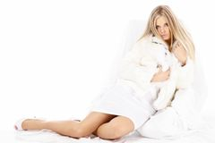 Temptress. Sexual beautiful blonde muffles up in the white fur coat, isolated Royalty Free Stock Photo