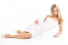 Temptress. Girl with beautiful figure, isolated on a white background Stock Photo