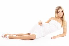 Temptress. Girl with beautiful figure, isolated on a white background Stock Photos