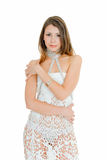 Temptress. Young charming woman in evening dress on white Royalty Free Stock Photography
