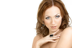 Temptress. The seductive woman with the bared shoulders in the jewelry, isolated Royalty Free Stock Images