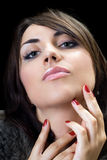 Temptress brunette. Close-up of temptress brunette. Isolated on black Stock Photography