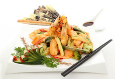 Tempura. Japanese fried tempura with shrimp and vegetables with zucchini garnish royalty free stock photo
