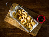 Tempura Fried Calamari. Served with barbeque souce Stock Images