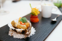 Tempura fried oyster in shell Stock Image