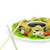 Tempura Maki Sushi - Deep Fried Roll made of Fresh Raw Salmon, Avocado and Cream Cheese inside with Sticks. Tempura Maki Sushi - Deep Fried Roll with Soybean Royalty Free Stock Photos