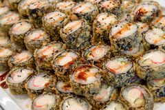 Tempura maki sushi plate. Huge plate of traditional tempura maki sushi at self service buffet, catering, Japanese cuisine stock image