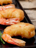 Tempura prawns on black plate. Stock Photography
