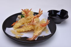 Tempura Prawns deep fried on black plate on white background Stock Images