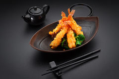 Tempura shrimp. On a black plate royalty free stock images