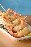 Tempura shrimp skewer. Tempura Jumbo Shrimp skewer on table with fried rice pasta Stock Photos