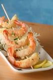 Tempura shrimp skewer. Tempura Jumbo Shrimp skewer on table with fried rice pasta Royalty Free Stock Photography