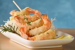 Tempura shrimp skewer. Tempura Jumbo Shrimp skewer on table with fried rice pasta Royalty Free Stock Photos