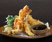 Tempura shrimps (deep fried shrimps). With soy sauce. Decorating dish of Japanese and Asian cuisine. Close up side view Royalty Free Stock Images